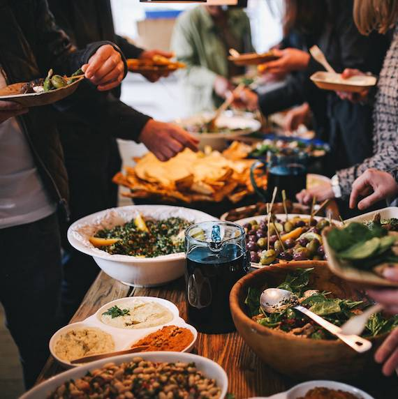 foodiesfeed.com_people-feasting-on-healthy-salad-buffet